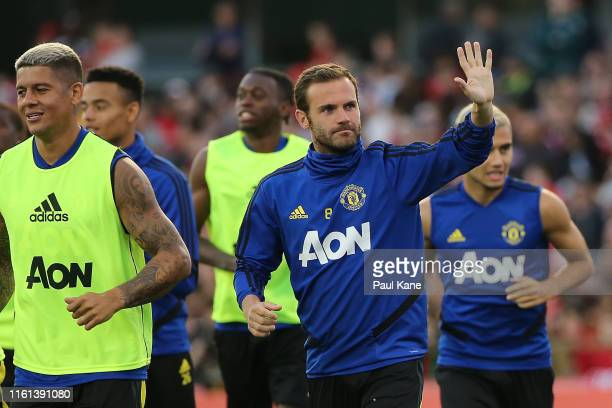 Juan Mata of Manchester United waves to spectators while warming up during a Manchester United training session at the WACA on July 11 2019 in Perth...