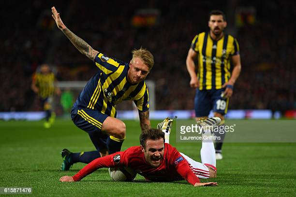 Juan Mata of Manchester United wins a penalty as he is brought down by Simon Kjaer of Fenerbahce during the UEFA Europa League Group A match between...