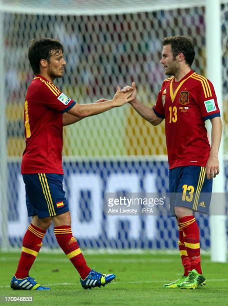 Juan Mata of Spain celebrates scoring his team's eighth goal with teammate David Silva during the FIFA Confederations Cup Brazil 2013 Group B match...