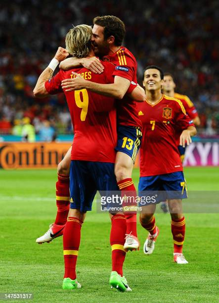 Juan Mata of Spain celebrates with team-mate Fernando Torres after scoring his team's fourth goal during the UEFA EURO 2012 final match between Spain...