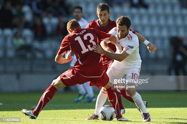 Juan Mata of Spain challenged by Marcel Gecov of Czech Republic during the UEFA European Under21 Championship Group B match between Czech Republic...