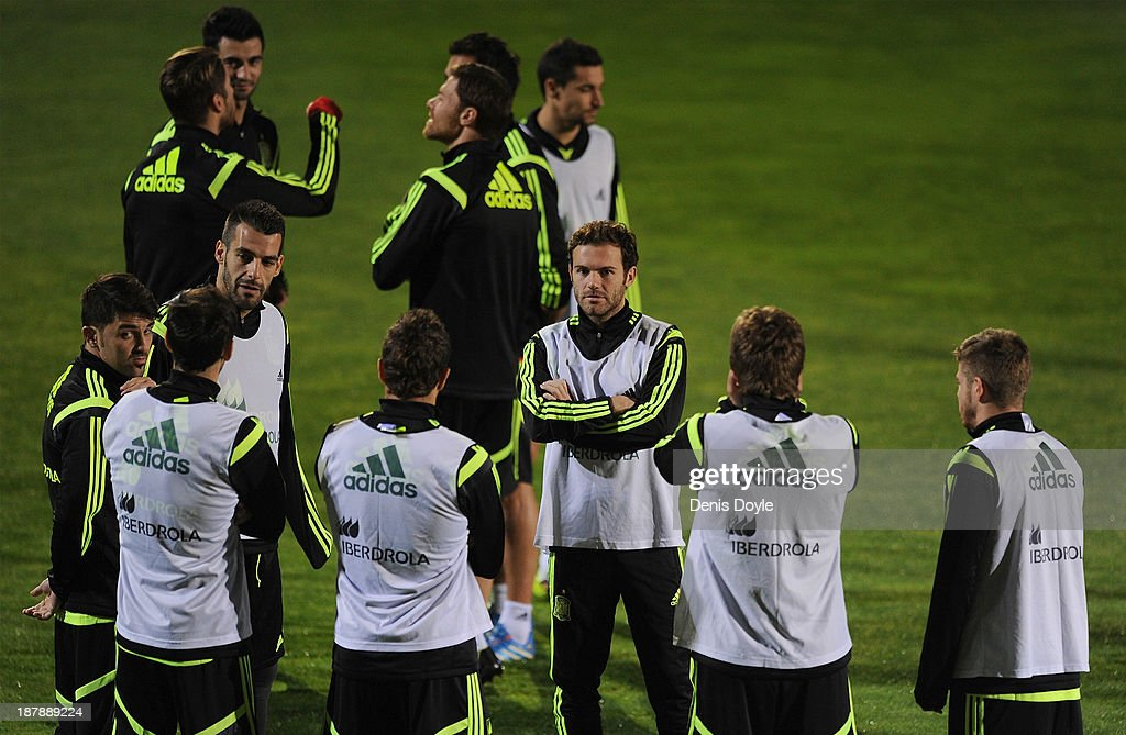 Juan Mata of Spain chats with team-mates during a training session ahead of their international friendly against Equatorial Guinea on November 13, 2013 in Las Rozas, Spain.