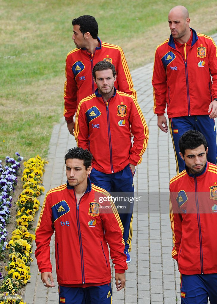 Juan Mata (C) of Spain walks amid his teammates Jesus Navas (L), Raul Albiol (R), Sergio Busquets (Top L) and Pepe Reina (Top R) on his way to a press conference ahead of UEFA EURO 2012 on June 7, 2012 in Gniewino, Poland.