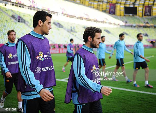 Juan Mata of Spain walks with Sergio Busquets Sergio Ramos and other teammates during a training session ahead of the UEFA Euro 2012 match against...