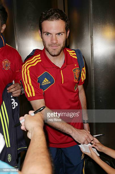Juan Mata of the Spain national soccer team arrives at Miami International Airport on June 4 2013 in Miami Florida