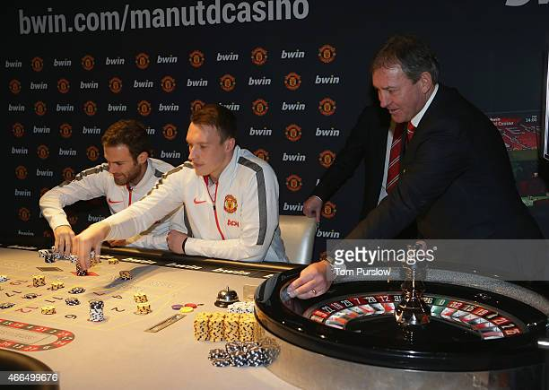 Juan Mata Phil Jones Denis Irwin and Bryan Robson of Manchester United attend the launch of the Manchester United bwin Casino App at Manchester 235...