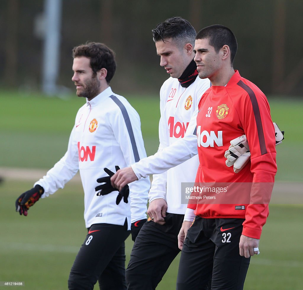 Juan Mata, Robin van Persie and Victor Valdes of Manchester United squad in action during a first team training session at Aon Training Complex on January 9, 2015 in Manchester, England.