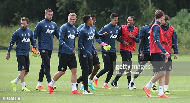 Juan Mata Sam Johnstone James Wilson Jesse Lingard Joel Pereira and Memphis Depay of Manchester United in action during a first team training session...