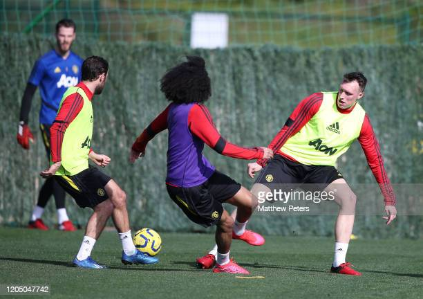 Juan Mata, Tahith Chong and Phil Jones of Manchester United in action during a first team training session on February 09, 2020 in Malaga, Spain.