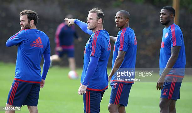 Juan Mata, Wayne Rooney, Ashley Young and Tyler Blackett of Manchester United in action during a first team training session at Aon Training Complex...