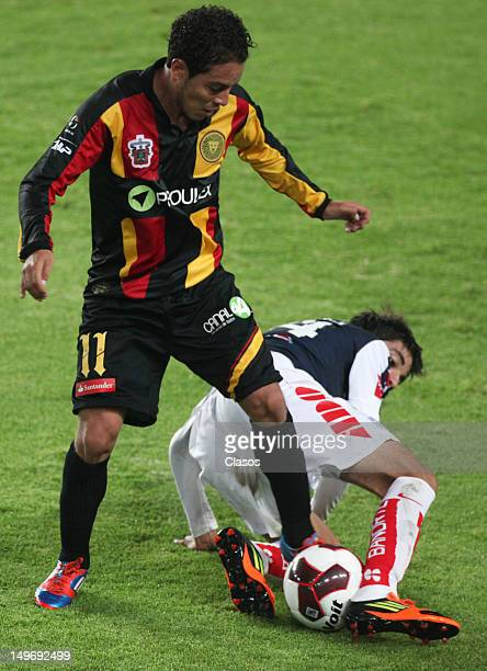 Juan Mendoza of Leones Negros struggles for the ball with Angel Herrera of Pachuca during a match between Pachuca and Leones Negros as part of the...