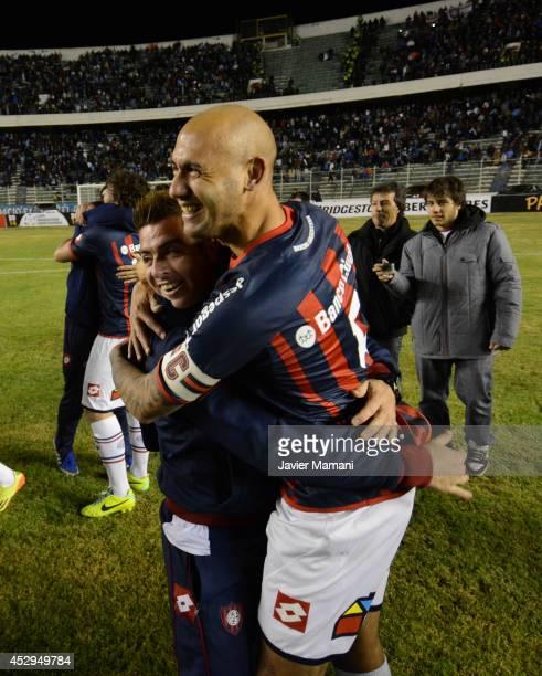 Juan Mercier and Julio Buffarini of San Lorenzo celebrate andvancing to the final after a second leg semifinal match between Bolivar and San Lorenzo...