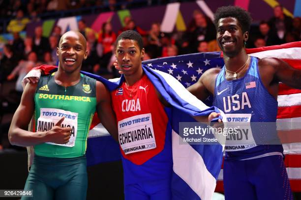 Juan Miguel Echevarria of Cuba celebrates winning the Long Jump Mens Final with Luvo Manyonga and Marquis Dendy of United States during the IAAF...