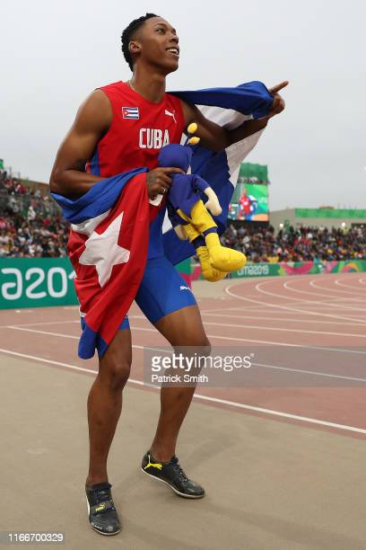 Juan Miguel Echeverría of Cuba celebrates after winning in Men's Long Jump Final on Day 12 of Lima 2019 Pan American Games at Athletics Stadium of...