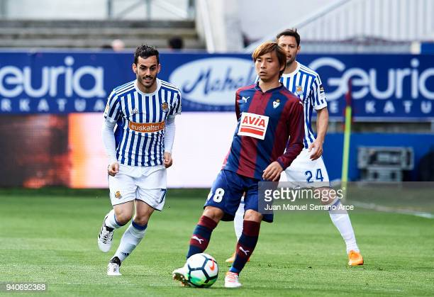 Juan Miguel Jimenez 'Juanmi' of Real Sociedad duels for the ball with Takashi Inui of SD Eibar during the La Liga match between SD Eibar and Real...