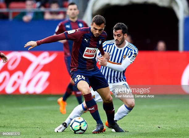 Juan Miguel Jimenez 'Juanmi' of Real Sociedad duels for the ball with Joan Jordan of SD Eibar during the La Liga match between SD Eibar and Real...