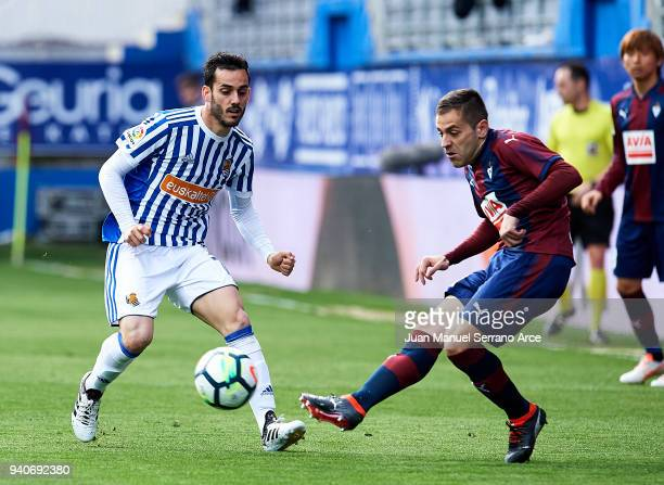 Juan Miguel Jimenez 'Juanmi' of Real Sociedad duels for the ball with Ruben Pena of SD Eibar during the La Liga match between SD Eibar and Real...
