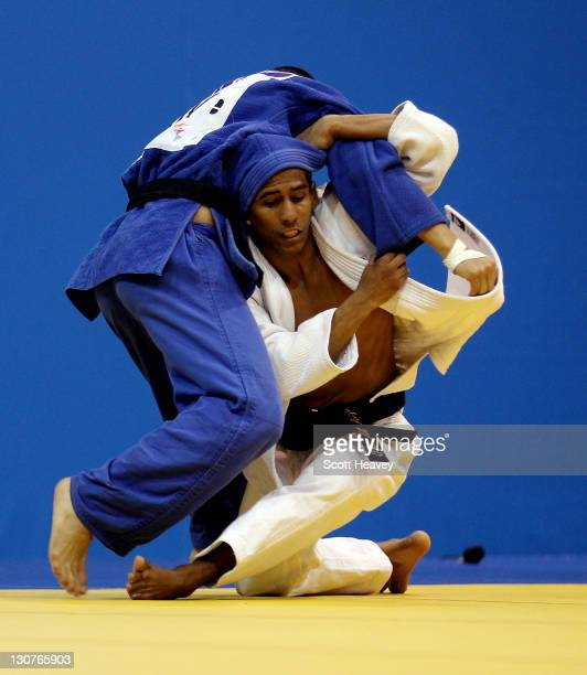 Juan Miguel Postigos of Peru in action with Kenny Godoy of Honduras during Men's Judo 60KG at the Code II Gymnasium during the XVI Pan American Games...