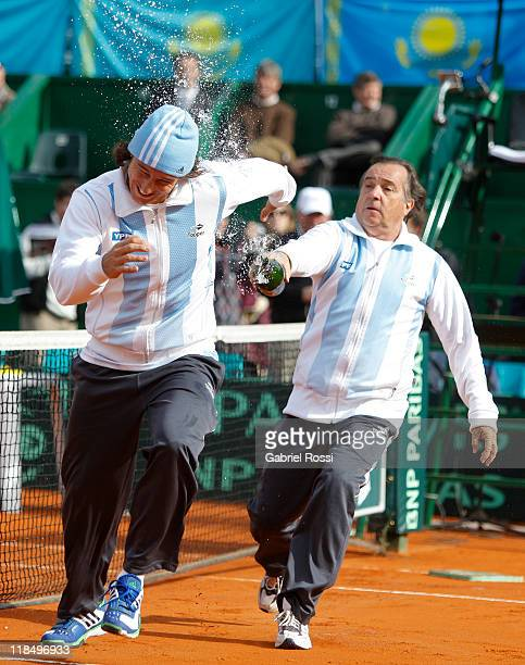 Juan Monaco and Modesto Vazquez of Argentina celebrate after the match between Argentina and Kazakhstan for second day in the quarters final of the...