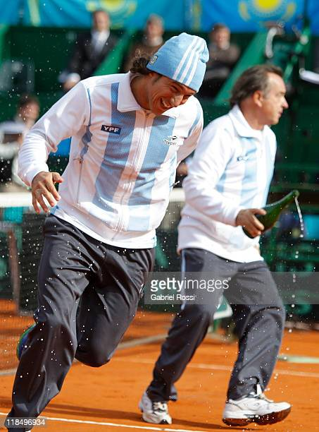 Juan Monaco and Modesto Vazquez of Argentine celebrate after the match between Argentina and Kazakhstan for second day in the quarters final of the...