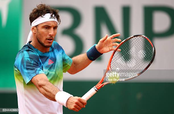 Juan Monaco of Argentina hits a background during the Men's Singles second round match against David Ferrer of Spain on day five of the 2016 French...