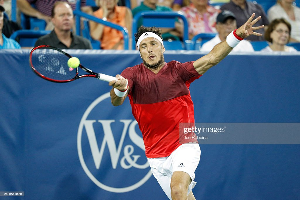 Juan Monaco of Argentina hits a return to Andy Murray of Great Britain on Day 5 of the Western & Southern Open at the Lindner Family Tennis Center on August 17, 2016 in Mason, Ohio.