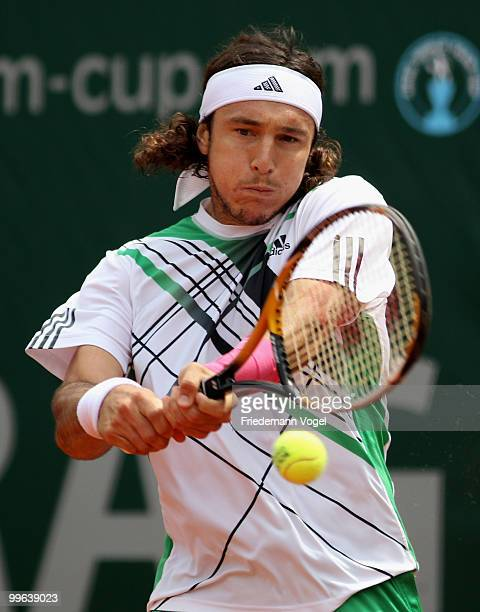 Juan Monaco of Argentina in action during his match against Victor Troicki of Serbia during the second day of the ARAG World Team Cup at the...