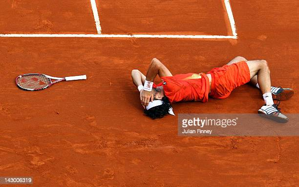 Juan Monaco of Argentina injures himself in his match against Robin Haase of Holland during day three of the ATP Monte Carlo Masters on April 17,...
