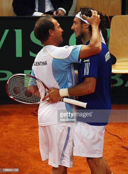 Juan Monaco of Argentina is hugged by team captain Martin Jaite after winning his match against Philipp Petzschner of Germany on day 1 of the Davis...