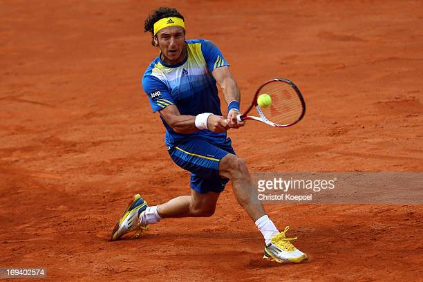 Juan Monaco of Argentina plays a backhand during the Power Horse World Team Cup semifinal between Guido Pella of Argentina and Juan Monaco of...