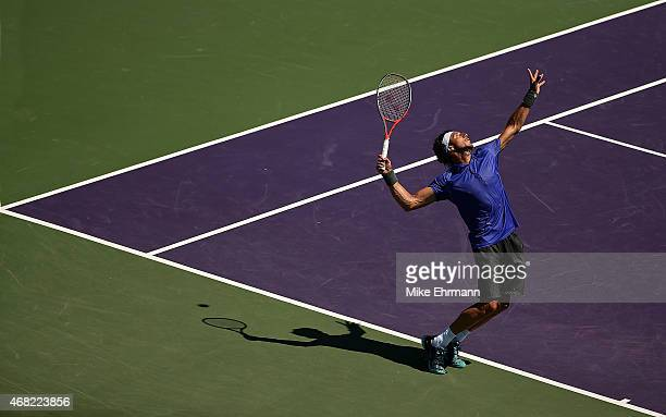Juan Monaco of Argentina plays a match against Fernando Verdasco of Spain during Day 9 of the Miami Open presented by Itau at Crandon Park Tennis...