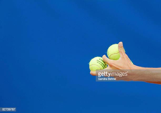 Juan Monaco of Argentina plays with the tennis balls during the BMW Open tournament on April 26 2005 in Munich Germany