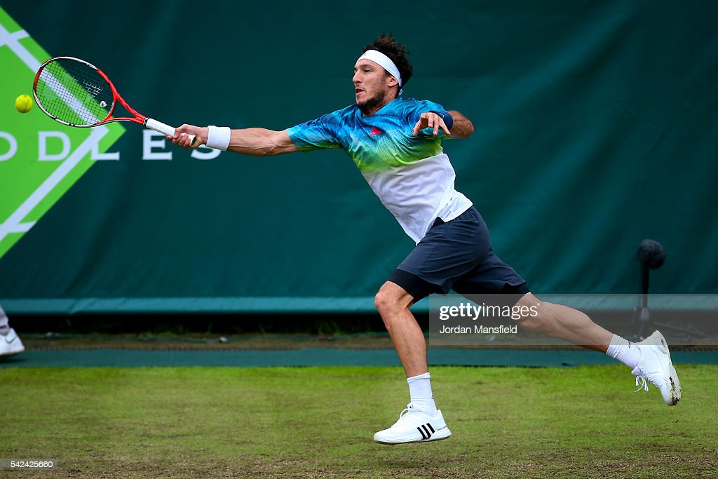 Juan Monaco of Argentina reaches for a forehand during his match against Nick Kyrgios of Australia during day three of The Boodles Tennis Event at Stoke Park on June 21, 2016 in Stoke Poges, England.