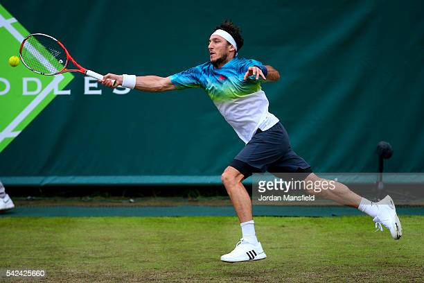 Juan Monaco of Argentina reaches for a forehand during his match against Nick Kyrgios of Australia during day three of The Boodles Tennis Event at...
