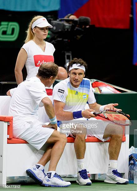 Juan Monaco of Argentina reacts as he sits next to his team captain Martin Jaite during day one of the Davis Cup semifinal match between Czech...