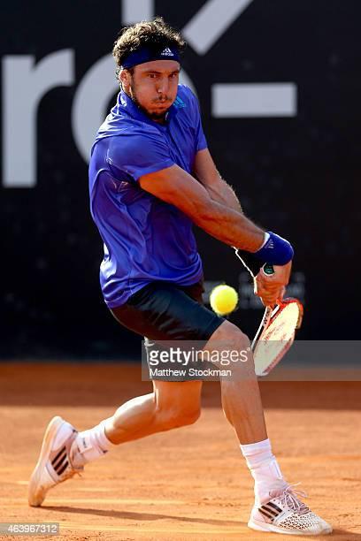 Juan Monaco of Argentina returns a shot to David Ferrer of Spain during the Rio Open at the Jockey Club Brasileiro on February 20 2015 in Rio de...