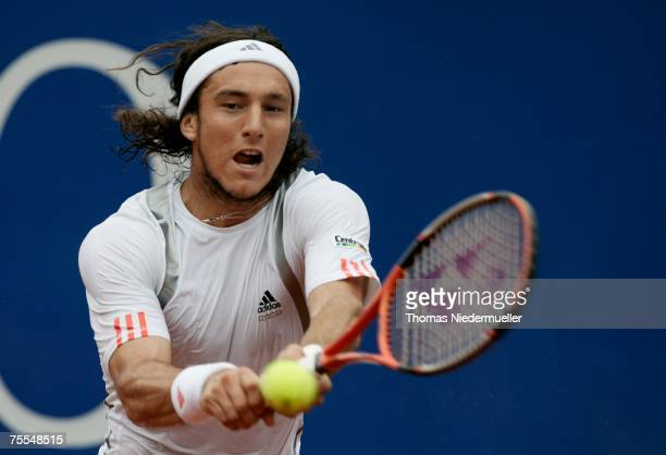 Juan Monaco of Argentina returns the ball to Stefan Koubek of Austria during the MercedesCup at TC Weissenhof on July 19 2007 in Stuttgart Germany