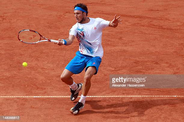 Juan Monaco of Argentinia plays a fore hand during his finale match against Janko Tipsarevic of Serbia during day 6 of Mercedes Cup 2012 at the TC...