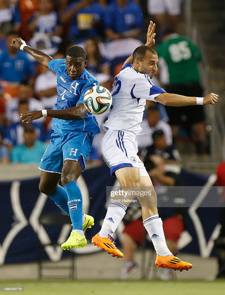 Juan Montes #4 of Honduras battles for the ball with Omer Damari #22 of Isreal during their Road to Brazil match at BBVA Compass Stadium on June 1, 2014 in Houston, Texas.