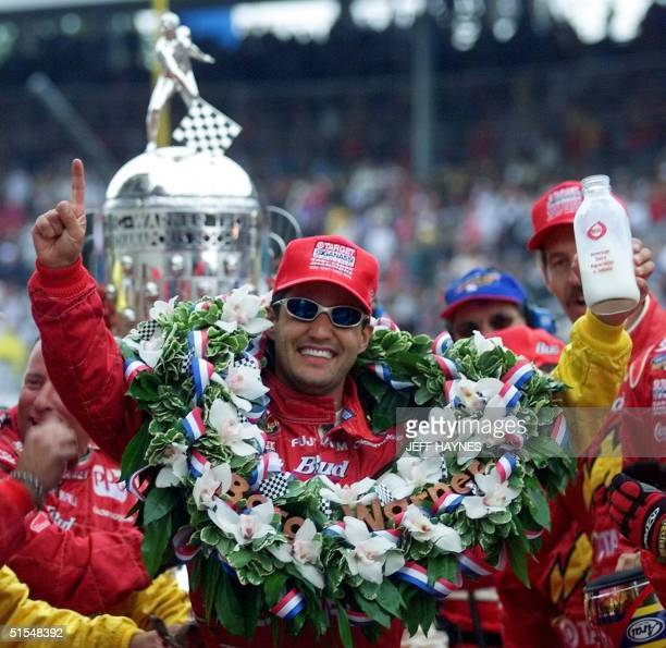 Juan Montoya of Colombia holds the jug of milk after winning the Indianapolis 500 28 May at the Indianapolis Motor Speedway in Indianapolis Montoya...