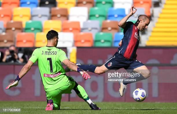 Juan Musso of Udinese Calcio makes a penalty foul against Rodrigo Palacio of Bologna FC during the Serie A match between Udinese Calcio and Bologna...