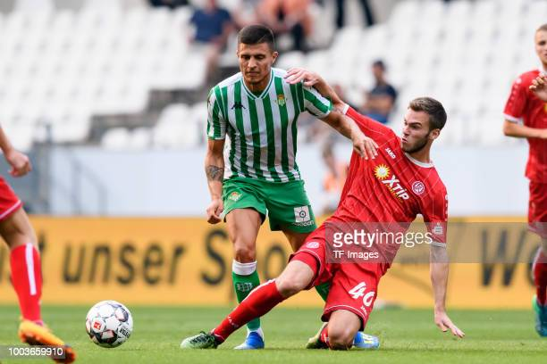 Milot Rashica of Werder Bremen and Lewis O`Brien of Huddersfield Town battle for the ball during the Interwetten Cup match between SV Werder Bremen...