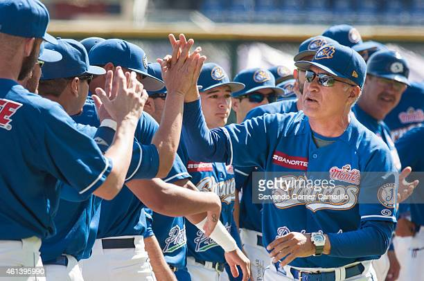 Juan Navarrete of Charros de Jalisco greets his teammates before the match against Yaquis of Obregon in the first game of semifinals of liga del...