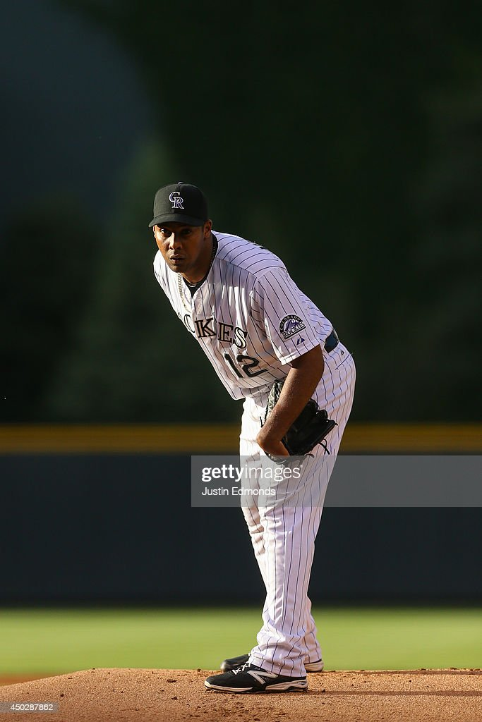Juan Nicasio #12 of the Colorado Rockies pitches against the Arizona Diamondbacks at Coors Field on June 5, 2014 in Denver, Colorado.