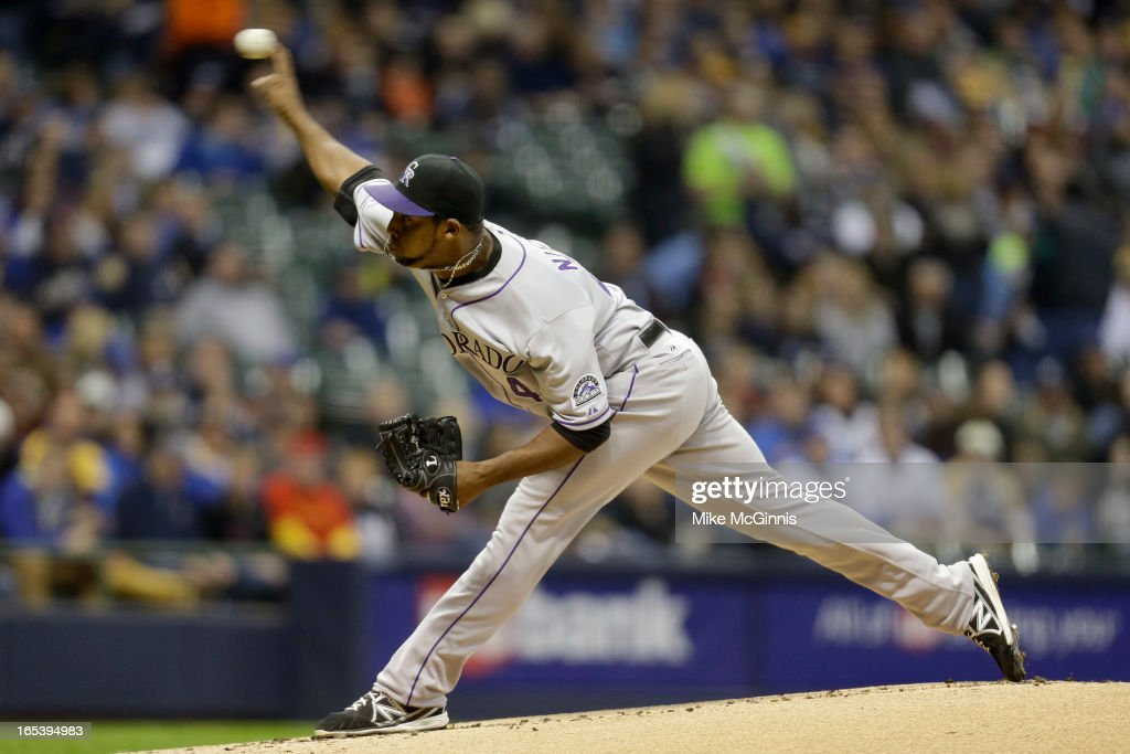 Juan Nicasio #44 of the Colorado Rockies pitches in the bottom of the first inning against the Milwaukee Brewers during the game at Miller Park on April 3, 2013 in Milwaukee, Wisconsin.