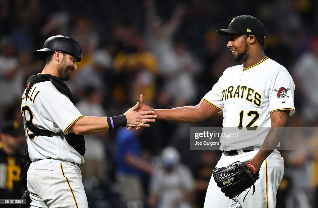 Juan Nicasio #12 of the Pittsburgh Pirates celebrates with Francisco Cervelli #29 after a 6-1 win against the Washington Nationals at PNC Park on May 17, 2017 in Pittsburgh, Pennsylvania.