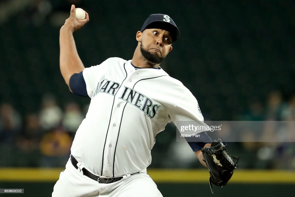 Juan Nicasio #12 of the Seattle Mariners pitches in the eighth inning against the Oakland Athletics at Safeco Field on May 1, 2018 in Seattle, Washington.