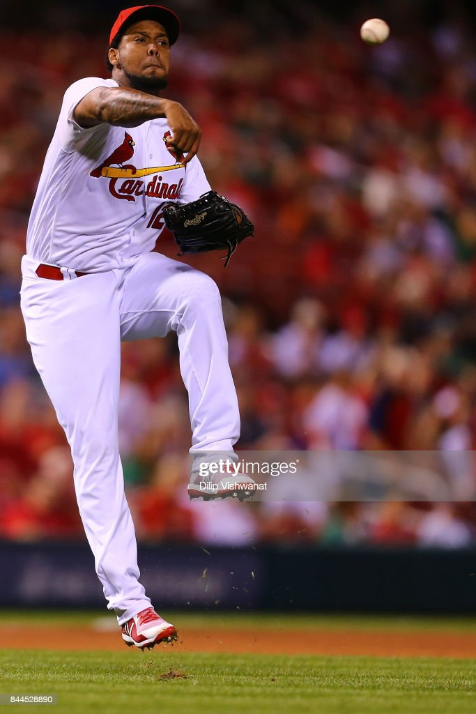 Juan Nicasio #12 of the St. Louis Cardinals throws a runner out against the Pittsburgh Pirates in the ninth inning at Busch Stadium on September 8, 2017 in St. Louis, Missouri.