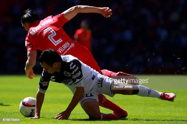 Juan Nuñez of Tijuana struggles for the ball with Efrain Velarde of Toluca during the 17th round match between Toluca and Tijuana as part of the...
