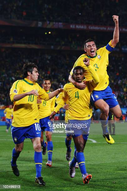 Juan of Brazil celebrates scoring his side's first goal from a corner with team mates Kaka and Lucio during the 2010 FIFA World Cup South Africa...